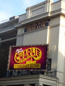 An external shot of the Royal Drury Lane Theatre, London, with the 'Charlie and the Chocolate Factory' sign