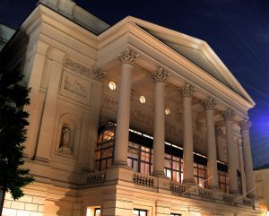A nighttime, external shot of the Royal Opera House, London