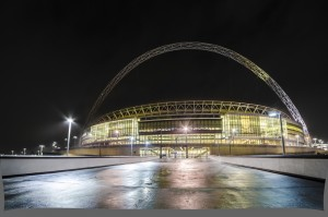 An external, nighttime shot of London's Wembley stadium