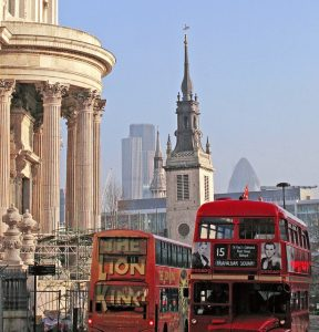 A variety of London sights and attractions in one photo, including London buses and St Paul's Cathedral