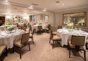 Wedding at DUKES LONDON in the St James Suite with circular tables set for dining