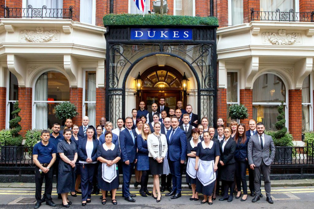 The DUKES LONDON team celebrating award win outside of the hotel